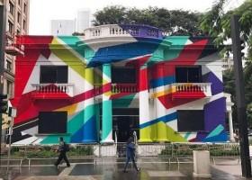Obra de grafiteiro colore casarão histórico na Avenida Paulista