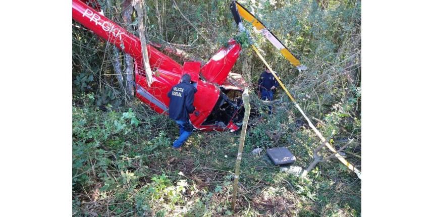 Piloto de helicóptero que caiu com cocaína em SP pediu ajuda de moradores para retirar droga